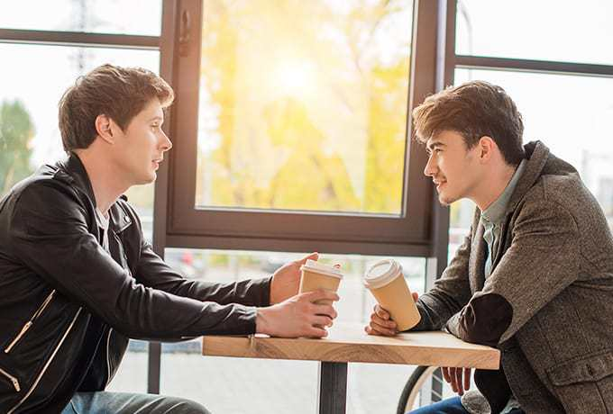 Two men sat together discussing suicide