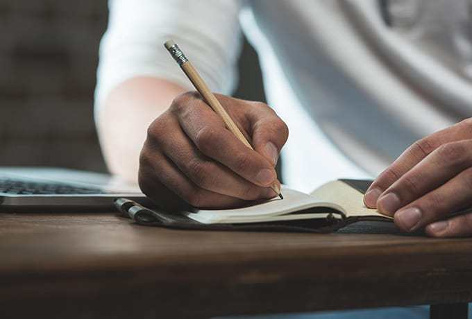 Man writing a suicide safety plan