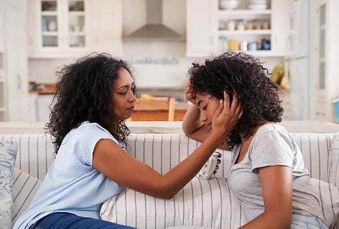 Supporting adolescents: Mother comforting her daughter bereaved by suicide