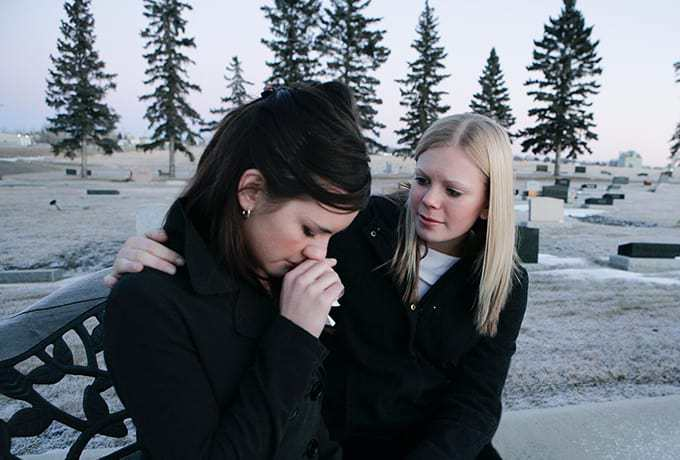Women supporting her friend after a suicide attempt