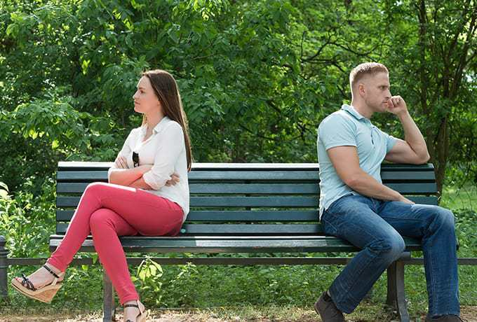 Toxic relationship - Man and women sitting together on a park bench