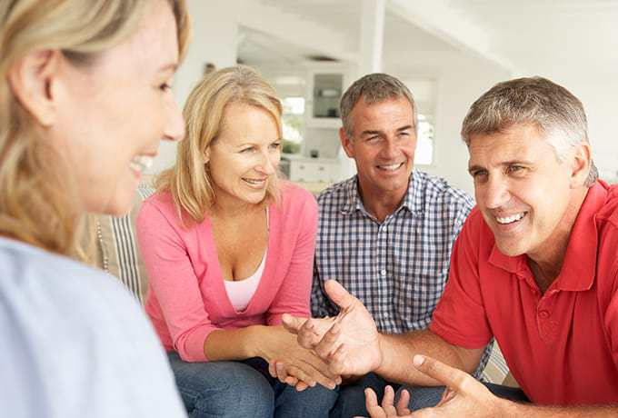 Support network of people sat round talking