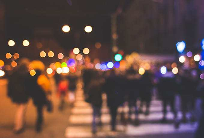 Blurred image of people walking in a city