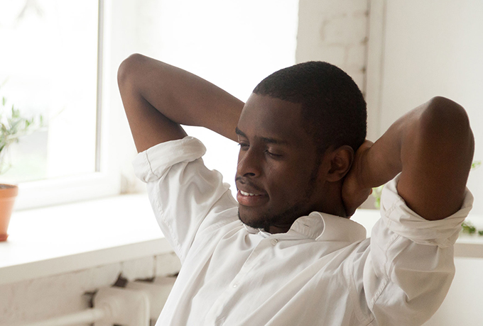 Man relaxing practicing mindfulness