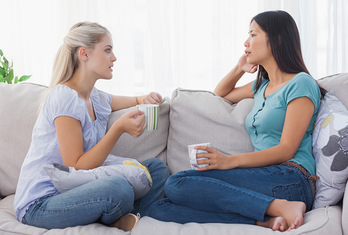 Two women sharing mental health lived experiences