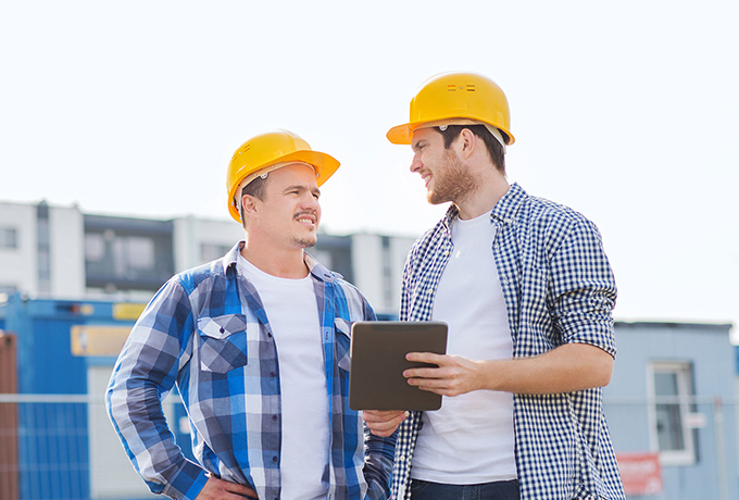 Two men on a building site talking