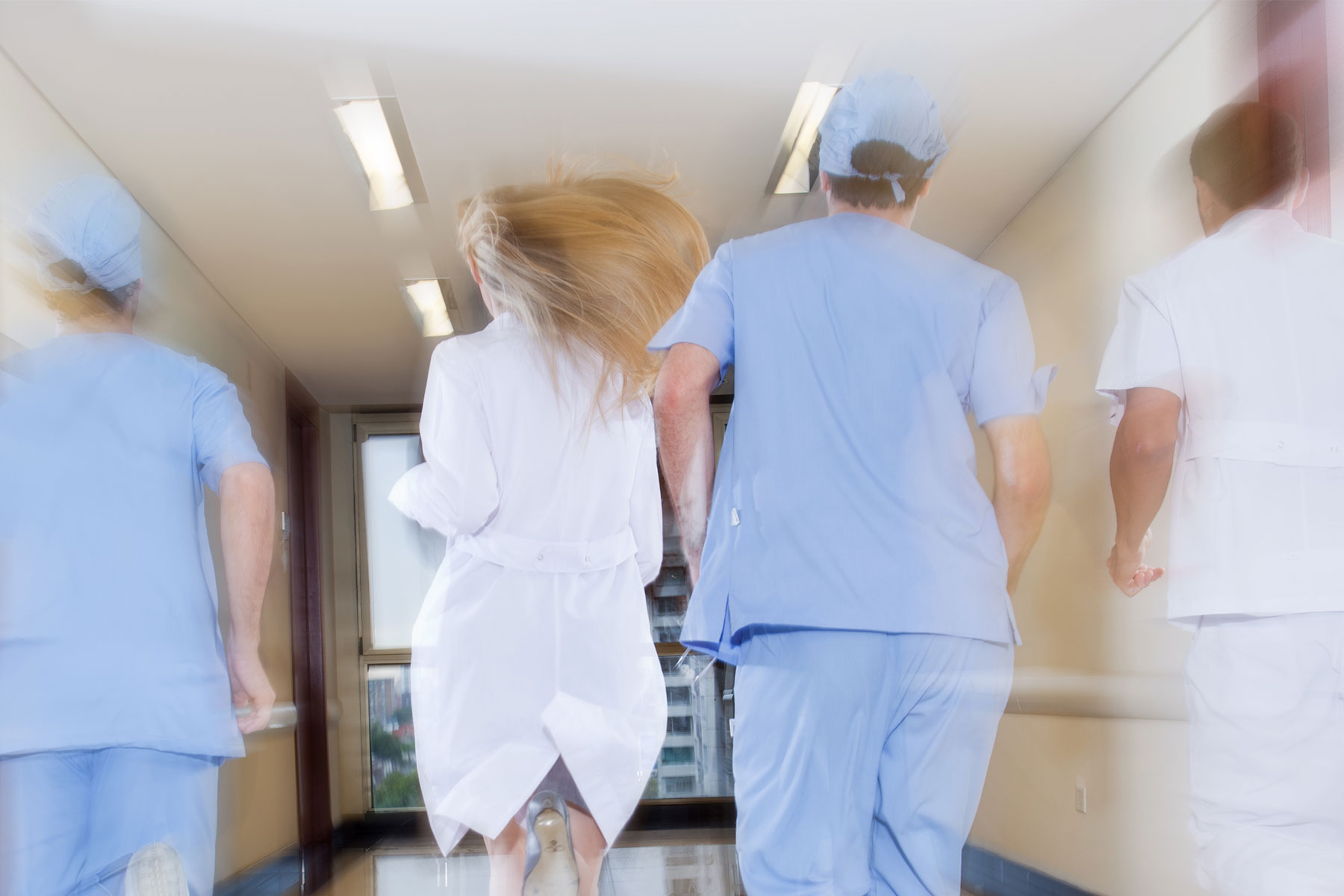 Crisis Assessment and Treatment Teams - doctors running down a corridor