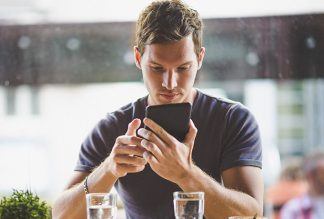 Man using ReMinder Suicide Safety plan app