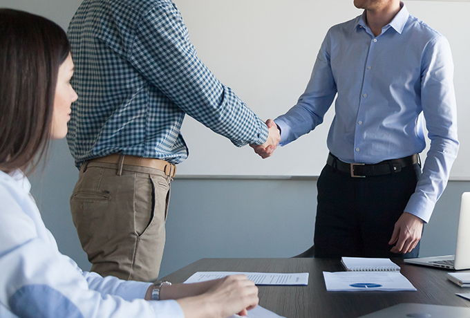 Work colleagues shaking hands