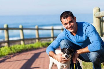 Man taking a mental health day walking his dog