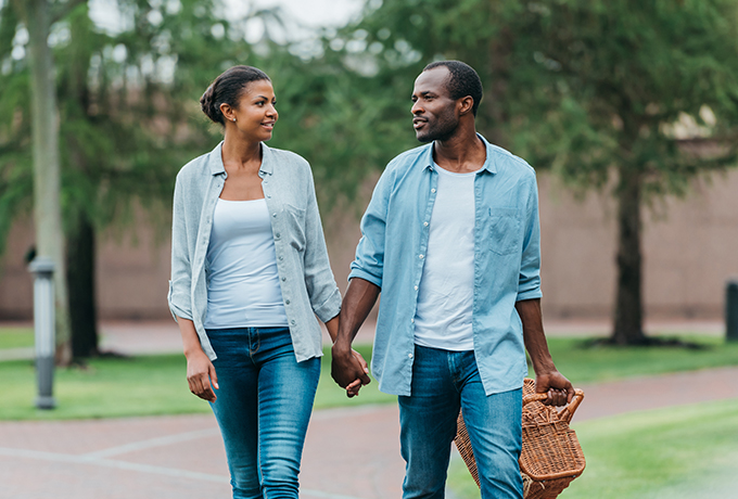 Couple walking together hand in hand